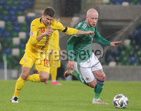 Press Eye - Belfast - Northern Ireland - 12th November 2020. UEFA Nations League 2021 - Northern Ireland Vs Romina at The National Stadium at Windsor Park, Belfast.. Northern Irelands Liam Boyce with Rominas Rzvan Marin. Picture by Jonathan Porter/PressEye