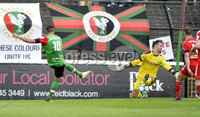4th August 2018. Danske Bank Irish premier league match between Glentoran and Cliftonville at The Oval in Belfast.. Glentorans John Higgins fires past Richard Brush to put his side into a 1-0 lead.  Mandatory Credit: Stephen Hamilton /Inpho