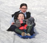 ©Lorcan Doherty February 12th 2018. . Isabel Nelis (10) and Hannah Gilmore (11) enjoying the Mid Term Break snow fall in Brooke Park.