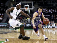 Press Eye - Belfast -  Northern Ireland - 01st December 2017 - Photo by William Cherry/Presseye. Manhattan College\'s Aaron Walker with Holy Cross\'s Caleb Green during Friday afternoons Basketball Hall of Fame Belfast Classic game at the SSE Arena, Belfast.