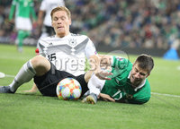 PressEye-Northern Ireland- 9th September  2019-Picture by Brian Little/PressEye. Northern Ireland  Patrick McNair   and Germany  Marcel Halstenberg   during Monday\'s  European Championship Qualifying Group C match  at the National  Football Stadium at Windsor Park,Belfast.. Picture by Brian Little/PressEye .