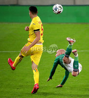 Press Eye - Belfast, Northern Ireland - 18th November 2020 - Photo by William Cherry/Presseye. Northern Ireland\'s Liam Boyce with Romania\'s Ionut Nedelcearu during Wednesday nights UEFA Nations League game at the National Football Stadium at Windsor Park, Belfast. Photo by William Cherry/Presseye