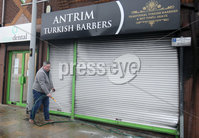 Press Eye - Belfast - Northern Ireland - 5th February 2019. The scene on Antrim\'s High Street where a newly open Turkish Barbers was gutted after an arson attack on Monday evening.  Firefighters tackled the blaze around 7.40pm on Monday night with police investigating the incident. . Michael Johnston, who owns a pizza takeaway shop next to the barbers, pictured cleaning up. . Picture by Jonathan Porter/PressEye