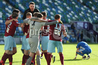 Press Eye-Belfast-Northern Ireland -27th July 2020. Sadlers\'s Peaky  Blinder Irish Cup Semi Final, National Stadium at Windsor Park, Belfast. . 27/7/2020. Ballymena United FC v Coleraine FC. Ballymena United\'s players celebrate with  goal keeper  Ross Glendinning after winning a penalty shoot-out against Coleraine.. Mandatory Credit  Brian Little/PressEye