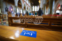 Press Eye - Belfast - Northern Ireland - 29th June 2020 -  . General view of a pew as Bishop of Down and Connor, Noel Treanor celebrates Mass under strict social distancing in St Peters Cathedral, west Belfast this morning.. The easing of lockdown continues at pace and today sees the reopening of churches across all faiths in Northern Ireland on a wider basis - provided they can adhere to social distancing and public hygiene requirements.. To date, they\'ve only been permitted to open for individual prayer or drive-in services.. Picture by Kelvin Boyes / Press Eye.
