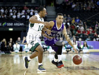 Press Eye - Belfast -  Northern Ireland - 01st December 2017 - Photo by William Cherry/Presseye. Manhattan College\'s Nehemiah Mack with Holy Cross\'s Patrick Benzan during Friday afternoons Basketball Hall of Fame Belfast Classic game at the SSE Arena, Belfast.