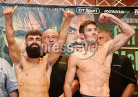 Press Eye - Belfast - Northern Ireland - 29th June 2018. Weigh in at the Europa Hotel in Belfast ahead of Michael Conlan\'s homecoming fight against Brazilian Adeilson Dos Santos at the SSE Arena on Saturday night. . Left to right.  Jono Carroll and Declan Geraghty go head-to-head after the weigh in. . Picture by Jonathan Porter/PressEye