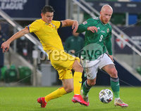 Press Eye - Belfast - Northern Ireland - 12th November 2020. UEFA Nations League 2021 - Northern Ireland Vs Romina at The National Stadium at Windsor Park, Belfast.. Northern Irelands Liam Boyce with Rominas Ionu Nedelcearu. Picture by Jonathan Porter/PressEye