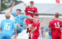 Press Eye - Belfast - Northern Ireland - 27th July 2018. SuperCupNI Cup International Youth Football Tournament at Ballymena\'s Showgrounds.  Supercut Final.  B Italia Vs Co. Down.. Co. Down\'s Ruari O\'Kane heads the ball clear. . Picture by Jonathan Porter/PressEye