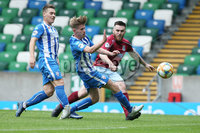 Press Eye-Belfast-Northern Ireland -27th July 2020. Sadlers\'s Peaky  Blinder Irish Cup Semi Final, National Stadium at Windsor Park, Belfast. . 27/7/2020. Ballymena United FC v Coleraine FC. Ballymena United\'s Cathair Friel challenged by  Lydon Kane and  Lydon Kane  of Coleraine.. Mandatory Credit  Brian Little/PressEye