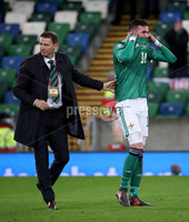 Press Eye - Belfast, Northern Ireland - 12th November 2020 - Photo by William Cherry/Presseye. Northern Ireland\'s Kyle Lafferty is inconsolable at the final whistle after a very difficult week personally and the team missing out on qualifying for the UEFA Euro 2020 tournament after being defeated by Slovakia 2-1 at the National Football Stadium at Windsor Park.   Photo by William Cherry/Presseye
