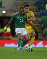 Press Eye-Belfast-Northern Ireland -18th November 2020. National Football Stadium at Windsor Park, Belfast. . 18/11/2020. Northern Ireland  Josh Magennis and   Romania Ionut Nedelcearu   during Wednesday   night\'s UEFA Nations League match at the National Football Stadium at Windsor Park,Belfast.. Mandatory Credit PressEye