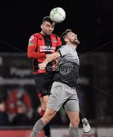 3/12/2019. Bet McLean league cup semi final between Crusaders and Institute at Seaview.. Crusaders Colin Coates  in action with Institutes Niall Grace. Mandatory Credit Inpho/Stephen Hamilton