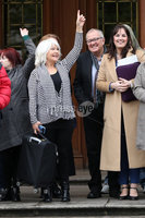 Press Eye - Historical Abuse Survivors - Court Of Appeal - 4th November 2019. Photograph by Declan Roughan. Margaret Mc Guckin SAVIA (Survivors & Victims of Institutional Abuse) raises her hand in victory outside the High Court In Belfast.. NI court of appeal rules civil servants can start compensation scheme for victims of historical abuse.. The court of appeal in Northern Ireland has ruled that the Executive Office has the power to bring forward a compensation scheme for victims of historical institutional abuse.. It follows a case brought by a survivor of historical abuse referred to in court as JR80 to see compensation payments made to victims in the absence of devolved ministers.. The ruling comes as Westminster considers legislation to introduce compensation payments before Parliament is dissolved on Tuesday ahead of the General Election..