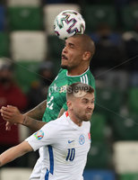 Press Eye-Belfast-Northern Ireland -12th November 2020. National Football Stadium at Windsor Park, Belfast. . 12/11/2020. Northern Ireland Josh Magennis    and Slovakia Albert Rusnak      during Thursday  night\'s UEFA Euro 2020  Play-off Final  at the National Football Stadium at Windsor Park,Belfast.. Mandatory Credit PressEye