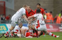 RaboDirect PRO 12, Thomond Park, Limerick 5/5/2012. Munster vs Ulster. Munster\'s BJ Botha tries to go past Tom Court and Iain Henderson of Ulster. Mandatory Credit ©INPHO/Billy Stickland