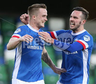 PressEye-Northern Ireland- 18th April 2017-Picture by Brian Little/PressEye. Linfield Aaron Burns celebrates after scoring a penalty with Andrew Waterworth against Glenavon Andy Kilmartin  during Easter Tuesday\'s Danske Bank Section A match at Windsor Park.. Picture by Brian Little/PressEye