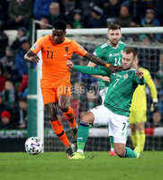 Press Eye - Belfast, Northern Ireland - 16th November 2019 - Photo by William Cherry/Presseye. Northern Ireland\'s Niall McGinn with Netherlands\' Quincy Promes during Saturday nights UEFA Euro 2020 Qualifier at the National Stadium, Belfast.     Photo by William Cherry/Presseye