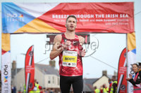 Press Eye - Belfast - Northern Ireland - 12th September 2020 . P&O Antrim Coast Half Marathon.. Athletics fans where in for a treat on Saturday when Sir Mo Farah ran and won the P&O Antrim Coast Half Marathon.. Marc Scott, comes in in second place.. Photo by Matt Mackey / Press Eye.
