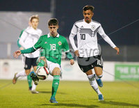 Press Eye - Belfast - Northern Ireland - 18th November 2019. Preparatory Friendly Tournament U19 2019 - Northern Ireland Vs Germany at Mourneview Park in Lurgan.. Northern Irelands Trai Hume with Germanys Oliver Batista Meier. Picture by Jonathan Porter/PressEye