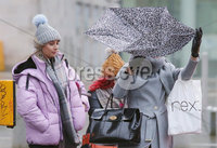 Press Eye - Belfast - Northern Ireland - 14th February 2018. People battle the wind in Belfast City Centre as strong winds and rain hit the country.. Picture by Jonathan Porter/PressEye