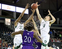 Press Eye - Belfast -  Northern Ireland - 01st December 2017 - Photo by William Cherry/Presseye.  . Manhattan College\'s Pauly Paulicap and Zane Waterman with Holy Cross\'s Jehyve Floyd during Friday afternoons Basketball Hall of Fame Belfast Classic game at the SSE Arena, Belfast.