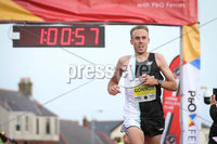 Press Eye - Belfast - Northern Ireland - 12th September 2020 . P&O Antrim Coast Half Marathon.. Athletics fans where in for a treat on Saturday when Sir Mo Farah ran and won the P&O Antrim Coast Half Marathon.. Ben Connor, comes in in third place.. Photo by Matt Mackey / Press Eye.