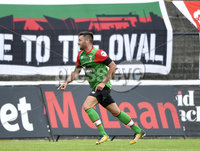 4th August 2018. Danske Bank Irish premier league match between Glentoran and Cliftonville at The Oval in Belfast.. Glentorans John Higgins celebrates after he  fires past Richard Brush to put his side into a 1-0 lead.  Mandatory Credit: Stephen Hamilton /Inpho