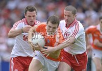 ©Russell Pritchard / Presseye  - 10th June 2012. Ulster GAA Football Senior Championship 2012 Quarter-Final : Armagh vs Tyrone at Morgan Athletic Grounds, Armagh. Armaghs Brendan Donaghy and Tyrones Conor Gormley with Stephen O\'Neill in action at Sundays Quarter Final.. ©Russell Pritchard / Presseye