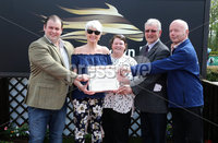 Press Eye - Belfast - Northern Ireland - 7th May 2018  - . May Day Meeting at Down Royal Racecourse.. SEAN GRAHAM BOOKMAKERS HANDICAP HURDLE. Pamela Ballantine makes a presentation to the owners of Castle Clyde. L-R: Mark Poots, Pamela Ballantine, Karen Poots, Brian Poots and Maurice Turkington.. Photo by Kelvin Boyes / Press Eye .