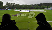 Mandatory Credit: Rowland White/Presseye. Cricket: One Day International. Teams: Ireland (green) v Australia (yellow). Venue: Stormont:. Date: 23rd June 2012. Caption: The dismal scene at Stormont after 10 overs