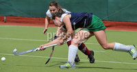 Mandatory Credit: Rowland White/Presseye. Women\'s Hockey: Irish Senior Cup Semi-Final. Teams: Queen\'s (blue) v Loreto (white). Venue: National Hockey Stadium, Dublin. Date: 12th May 2012. Caption: Claire Buchanan, Queen\'s and Lizzie Colvin, Loreto