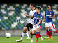 Press Eye - Belfast -  Northern Ireland - 10th July 2019 - Photo by William Cherry/Presseye/Inpho. Linfield\'s Jordan Stewart with Rosenborg\'s Even Hovland during Wednesday nights Champions League, Qualifying First Round, 1st Leg game at the National Stadium at Windsor Park, Belfast.