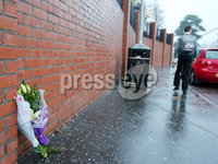 Press Eye - Belfast - Northern Ireland - 4th December 2018. Flowers at the scene on the Glen Road in west Belfast where Jim Donegan, aged in his 40s, was shot dead on Tuesday afternoon as he sat waiting in his car to pick up his son from St Marys Christian Brothers Grammar School.. Picture by Jonathan Porter/PressEye