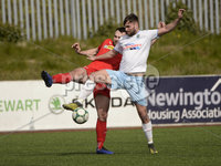 13th April 2019. Danske Bank Irish premiership. Cliftonville v Ballymena United at Solitude Belfast.. Cliftonville\'s Jamie Harney  in action with Ballymena\'s  Johnny McMurray. Mandatory Credit -Inpho/Stephen Hamilton .