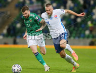 Press Eye - Belfast - Northern Ireland - 12th November 2020. European Championship 2020.  Playoff for Final Tournament - Northern Ireland Vs Slovakia at The National Stadium at Windsor Park, Belfast.. Northern Irelands Stuart Dallas with Slovakias Milan Skriniar.. Picture by Jonathan Porter/PressEye