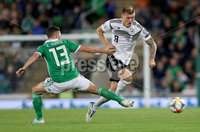 Press Eye - Belfast -  Northern Ireland - 09th September 2019 - Photo by William Cherry/Presseye . Northern Ireland\'s Corry Evans with Germany\'s Toni Kroos during Monday nights European Championship Qualifier at the National Stadium at Windsor Park, Belfast.  Photo by William Cherry/Presseye