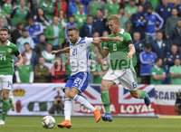 8th August 2018. Northern Ireland v Bosnia & Herzegovina at the national stadium in Belfast.. Northern Ireland\'s George Saville  in action with  Bosnia & Herzegovina\'s Elvis Saric.  Mandatory Credit: Stephen Hamilton /Presseye