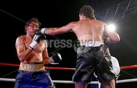 Picture -  Kevin Scott / Presseye. Belfast - Northern Ireland - Saturday 1st August 2015 - Feile Big Fight Night - (No Repro Fee) . Pictured is the fight between Tommy McCarthy (Black and Green Shorts) vs Courtney Fry (Black and Gold Shorts)  at the Feile big fight night in Belfast, Northern Ireland . . Picture - Kevin Scott / Presseye