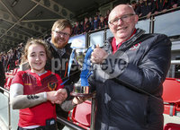 Press Eye Belfast - Northern Ireland 14th March 2019. Danske Bank Ulster Schools Girls X7s Senior Cup Final. Enniskillen Royal Grammar School(in red) vs Loreto Secondary School Letterkenny.. Enniskillen\'s captain Katie Hetherington lift\'s the cup after winning the final and is pictured with Ulster Rugby President Stephen Elliott(right) and Danske Bank Bloomfield Bangor Branch manager Nick Craig. . . Picture by Jonathan Porter/PressEye.com