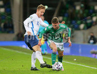 Press Eye - Belfast - Northern Ireland - 12th November 2020. European Championship 2020.  Playoff for Final Tournament - Northern Ireland Vs Slovakia at The National Stadium at Windsor Park, Belfast.. Northern Irelands Gavin Whyte with Slovakias Tomas Hubocan. Picture by Jonathan Porter/PressEye