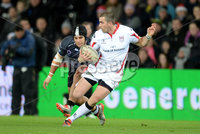 Press Eye - Belfast - Northern Ireland - 20th December 2014 - Picture by Ben Evans/ Press Eye . Ospreys v Ulster - Guinness PRO12 -. Ruan Pienaar of Ulster ties to get away from Josh Matavesi of Ospreys..