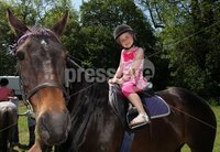 Northern Ireland- 27th May 2012 Mandatory Credit - Photo-Jonathan Porter/Presseye The National Countrysports Fair at Moria Demesne.  Five-year-old Brooke Montgomery from Magherafelt enjoys some pony trekking.