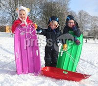©Lorcan Doherty February 12th 2018. Mid Term Break Snow Fall. Darcy, Caleb and Reuben Boyle enjoying the snow fall in Brooke Park, Derry.