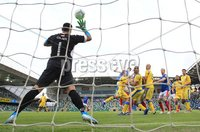 UEFA Europa League- Qualifying Third Round-2nd Leg, Windsor Park, Belfast  12/8/2019. Linfield FC vs FK FK Sutjeska. Linfield\'s Mark Stafford scores the opening goal against           FK Sutjeska goalkeeper Vlado Giljen. Mandatory Credit  INPHO/Brian Little