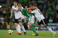 Press Eye - Belfast - Northern Ireland - 9th September 2019 - Picture Matt Mackey / Press Eye.. EURO qualifier 2020 Stadium at Windsor Park, Belfast. Northern Ireland Vs Germany.. Northern Ireland\'s George Saville with Germany\'s Joshua Kimmich.