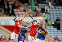Munster GAA Hurling Intermediate Championship 2012 Semi-Final, Páirc Uí Chaoimh 24/6/2012. Cork vs Tipperary. Cork\'s Kevin O\'Gorman and Brian O\'Sullivan with Joe Gallagher and Kieran Morris of Tipperary. Mandatory Credit ©INPHO/Cathal Noonan