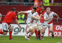 RaboDirect PRO 12, Thomond Park, Limerick 5/5/2012. Munster vs Ulster. Munster\'s Wian du Preez comes in to tackle Adam D\'arcy supported by Nevin Spence of Ulster. Mandatory Credit ©INPHO/Billy Stickland