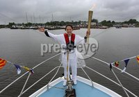 Presseye Northern Ireland - 05th June 2012 Mandatory Credit - Photo-William Cherry/Presseye. Torch Bearer Eorann O\'Neill as the Olympic Flame makes its way across Lough Neagh on board a local fishing boat. The Torch travelled across the water from Antrim Harbour to Ballyronan on the final day of the Olympic Torch Relay. It also visited Newcastle, Downpatrick and Ballymena, as once again thousands of people came out to cheer the Torch despite the rain, before departing from Larne Harbour for Scotland at 4pm.