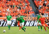 ©Press Eye Ltd Northern Ireland - 1st June 2012. Mandatory Credit - Picture by Darren Kidd/Presseye.com .  . Netherlands v Northern Ireland at the Amsterdam Arena.. Northern Ireland\'s Andrew Little with Holland\'s Arjen Robben